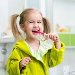 lowry_dental_boise_featured_image_happy_girl_brushing_teeth